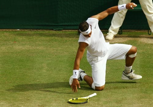 Spain's Rafael Nadal slips during his match against Switzerland's Roger Federer during the men's singles final on the Centre Court at Wimbledon.