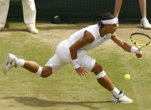 Spain's Rafael Nadal, returns to Switzerland's Roger Federer, during the Men's Singles final on the Centre Court at Wimbledon.