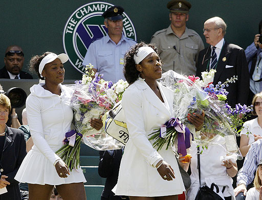 Serena Williams of the US walks with her sister Venues onto the Centre Court for the start of the women's singles final at Wimbledon on July 5, 2008.