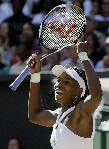 Venus Williams of the US reacts after winning the women's singles final against her sister Serena on the Centre Court at Wimbledon on July 5, 2008.