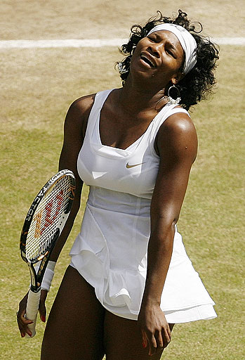Serena Williams reacts during her women's singles final against her sister Venus, on the Centre Court at Wimbledon on July 5, 2008.