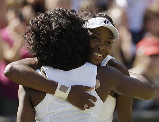 Venus Williams embraces her sister Serena, after defeating her to win the Women's Singles Championship on the Centre Court at Wimbledon on July 5, 2008.