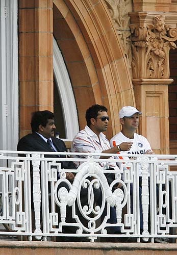 Sachin Tendulkar watches the match against England from the players' dressing room during the Super 8 stage of the ICC World Twenty20 at Lord's in London. India, the defending champions, needed a win to stay in the tournament after losing their opening Super Eights match against the West Indies at Lord's. (AFP Photo)