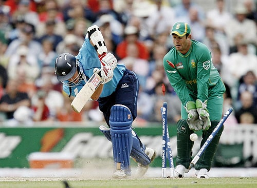 Scotland's Neil McCallum is bowled by South Africa's Johan Botha as wicketkeeper Mark Boucher looks on during their ICC World Twenty20 match at the Oval cricket ground in London. (AFP Photo)