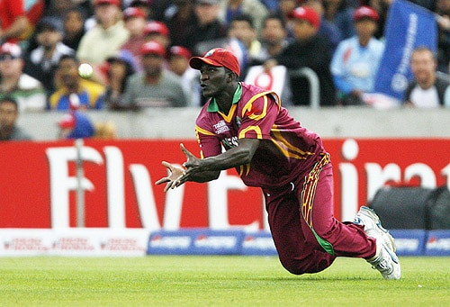 West Indies' DDarren Sammy catches Sri Lanka's Jehan Mubarak for seven runs during the semi-final stage of the ICC World Twenty20 at the Oval in London. (AFP Photo)