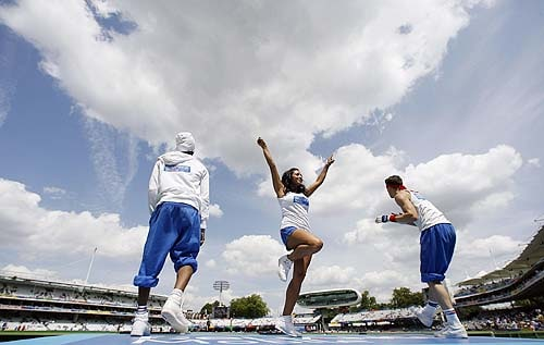 The Reliance Mobile dancers perform during the Super 8 stage of the ICC World Twenty20 at Lord's in London. (AFP Photo)