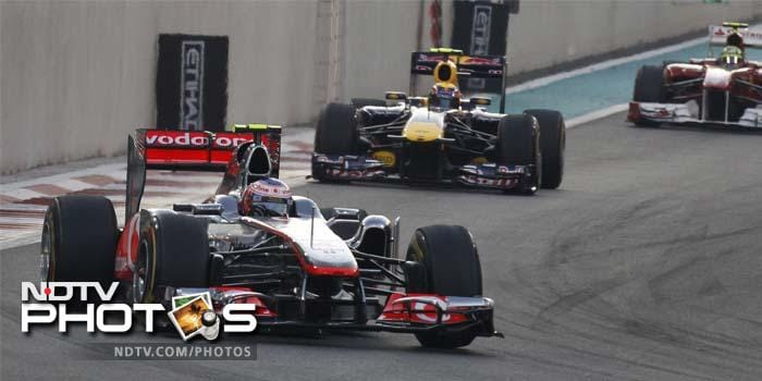 Jenson Button of McLaren is seen here driving ahead of Mark Webber in his Red Bull. Button finished the race third, behind Fernando Alonso.