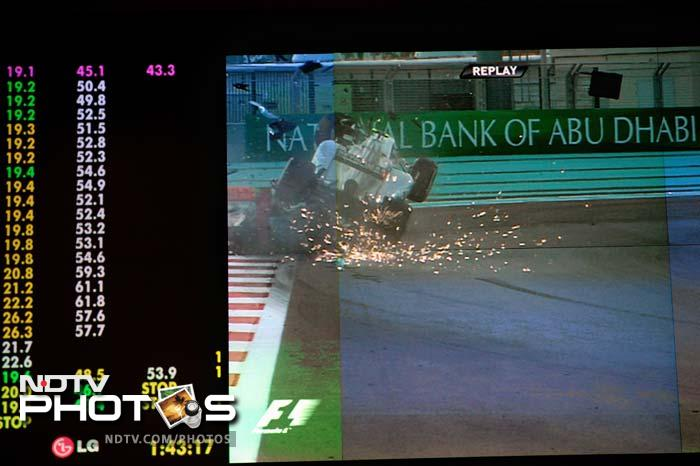 A TV shot of Nico Rosberg crashing into the walls after his car hit and jumped over Narain Karthikeyan's HRT. Both drivers walked out unharmed.
