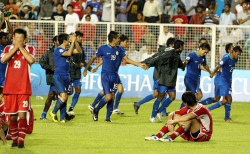 India's players celebrated after winning the AFC Challenge Cup final 4-1, while Tajikistan's players are dejected.
