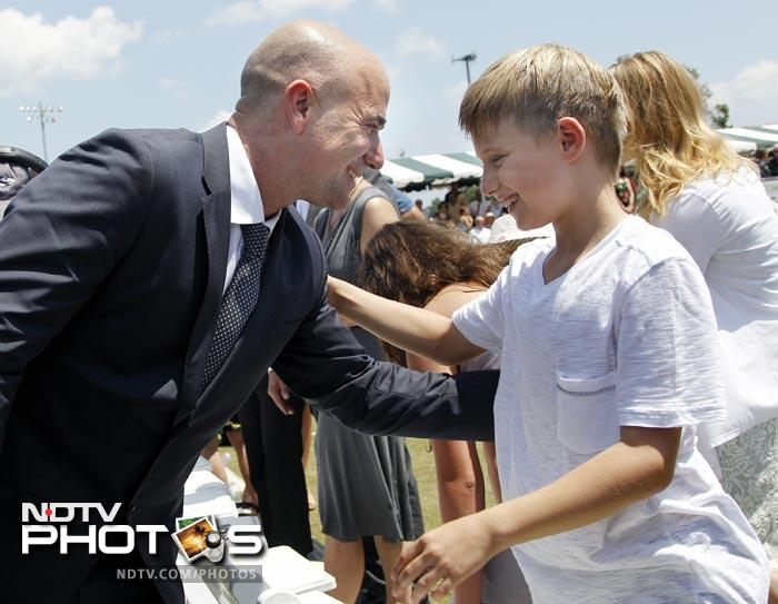 Agassi greets his son, Jaden, 9, after being inducted to the International Tennis Hall of Fame in Newport. (AP Photo)