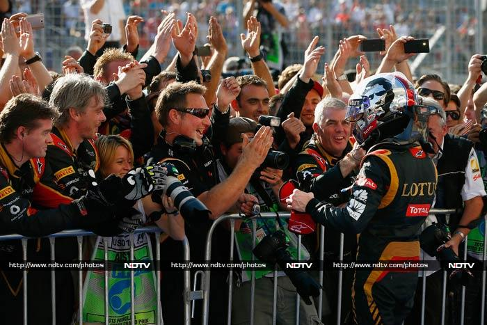 Lotus team members are seen celebrating Grosjean's win. <br><br>The other car - driven by Kovalainen finished the race 14th.