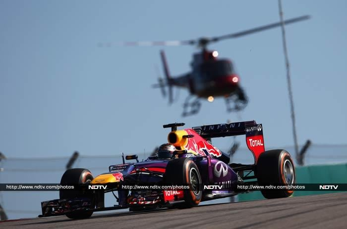 Vettel climbed out of his Red Bull car, pumped his right first then held up eight fingers, one for each of his consecutive victories. <br><br> He broke Michael Schumacher's record of most consecutive wins, set in 2004.