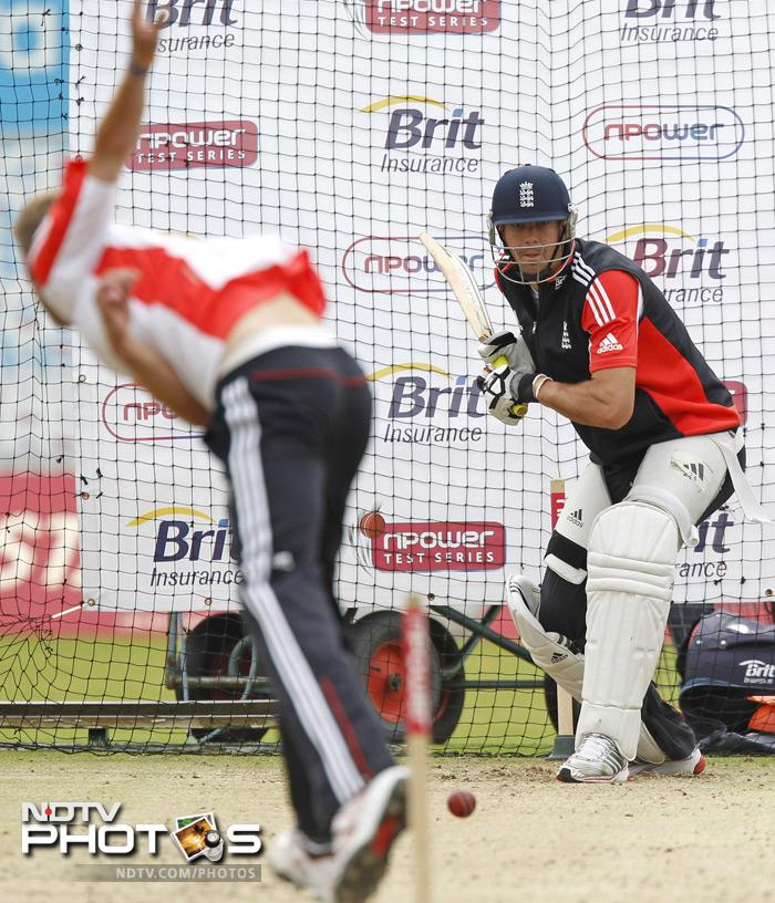 England's Kevin Pietersen (R) bats in the nets during a team training sesion. (AFP Photo)