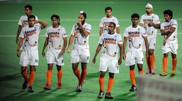 Indian hockey captain Rajpal Singh (4th L) gestures as he leaves with teammates after losing against Argentina during their World Cup 2010 classification match for 7th and 8th place at the Major Dhyan Chand Stadium. Argentina won by 4-2. (AFP Photo)