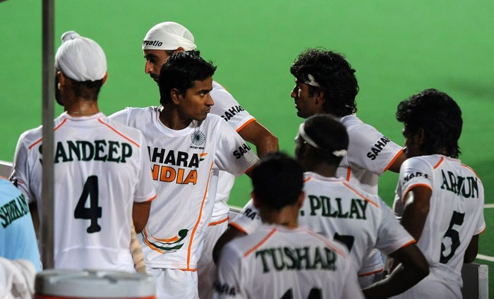 Indian hockey players stand dejected after losing against Argentina during their World Cup 2010 classification match for 7th and 8th place at the Major Dhyan Chand Stadium in New Delhi. Argentina won by 4-2. (AFP Photo)
