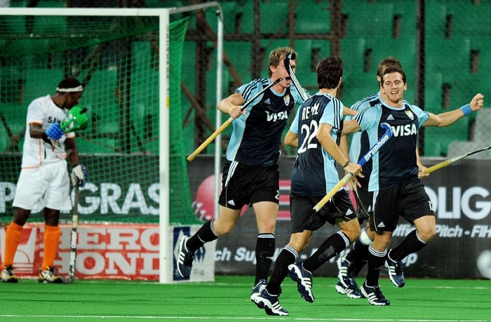 Argentinian Hockey player Lucas Vila (R) celebrates after scoring a goal against India during their World Cup 2010 Classification match at the Major Dhyan Chand Stadium in New Delhi. Argentina beat India 4-2. (AFP Photo)