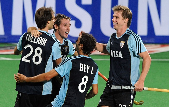 Argentinian hockey player Facundo Callioni (L) celebrates a goal against India with teammate Matias Paredes (L) during their World Cup 2010 classification match for 7th and 8th place at the Major Dhyan Chand Stadium. Argentina won 4-2. (AFP Photo)