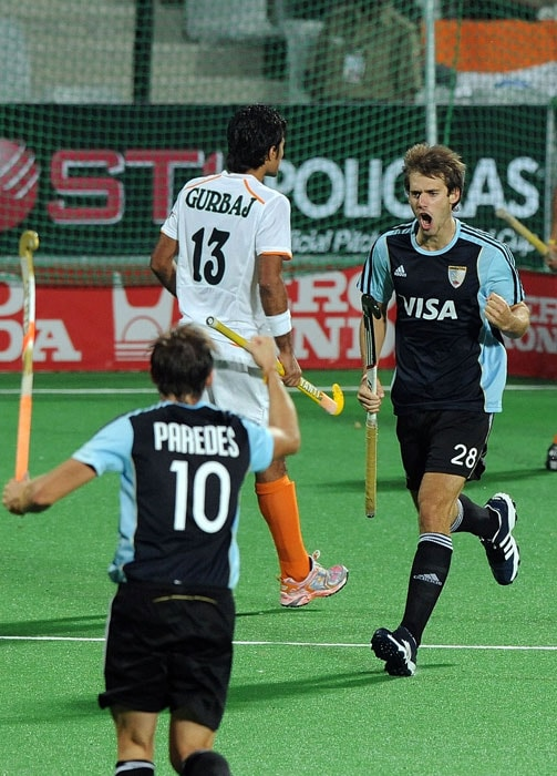 Argentinian hockey player Facundo Callioni (R) celebrates a goal against India with teammate Matias Paredes (L) during their the World Cup 2010 classification match for 7th and 8th place at the Major Dhyan Chand Stadium (AFP Photo)