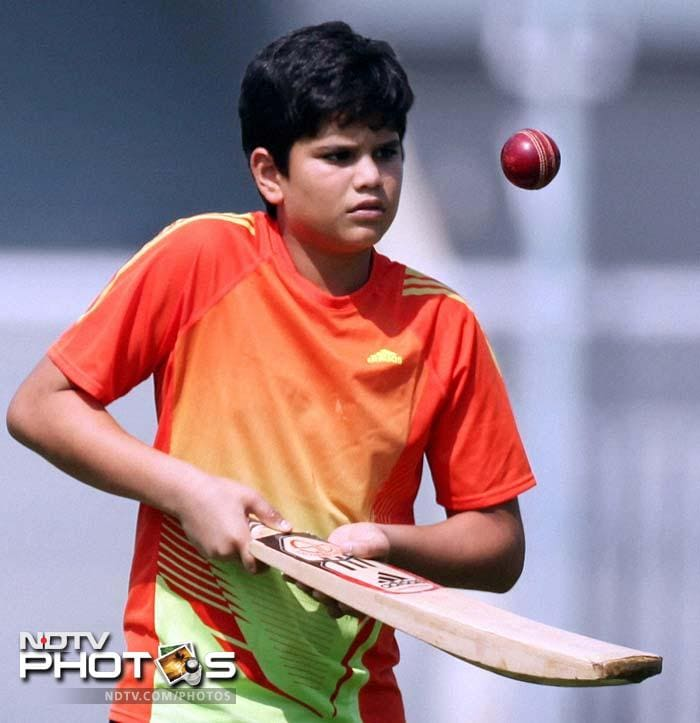 India's practice session at the CCI grounds in Mumbai had a visitor in Arjun Tendulkar, who watched daddy Sachin and others go through the paces. (AP & AFP Photos)