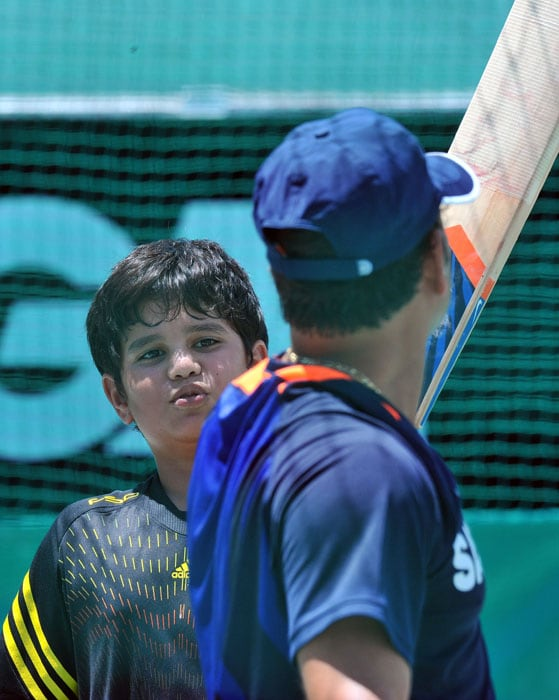 While the Indian team was busy slogging it out at the nets at the Newlands ground on Saturday, Arjun was seen practicing at the crease on a side net. (AFP Photo)