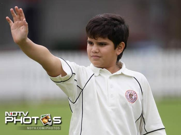 Arjun, Sachin Tendulkar's son, slammed the first century of his blooming career in the Mumbai Cricket Association's Under-14 selection trials held at the Cross Maidan in Mumbai on Saturday.<br><br>The 12-year old made 124 to help Khar Gymkhana beat Goregaon Centre by an innings and 21 runs and enter the final of the tournament. He hit 14 boundaries and a six during his knock.<br><br>Arjun, who is a left-hander unlike his father, had scored 64 runs in his previous match during this MCA summer vacation tournament that also serves as selection trials to the U-14 team.<br><br><b>Coming Up:</b> Arjun practises with Sachin and Sehwag