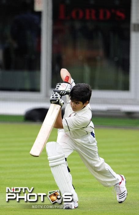 A natural left-hander, the young Tendulkar was seen practising under his father's supervision. But it's not the first time. (AP Photo)