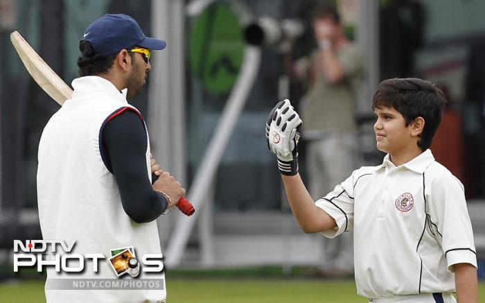 While the Indian team was practising hard at the Lord's ground for its 100th Test against England, there was another player who caught everyone's eye for obvious reasons. Arjun, Sachin Tendulkar's 11-year-old son was seen practising with Yuvraj Singh. (AFP Photo)