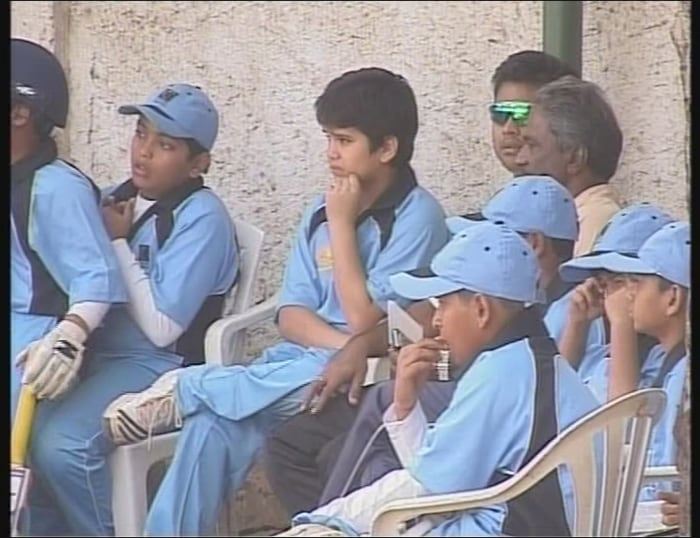 A demoralized Arjun Tendulkar looks on as his team succumbs to the Cadence Cricket Academy in a 30-over match of the Cadence Trophy in Pune.