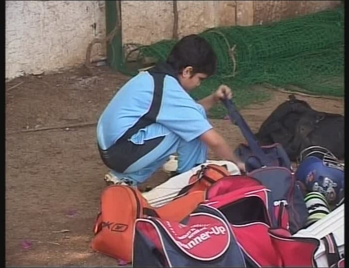 Junior Tendulkar packs his bag after his team, MIG, was beaten by the Cadence Cricket Academy. Arjun, a left handed batsman, was run-out as a result of a miscommunication with his opening partner.