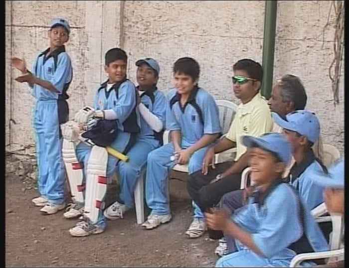 Arjun Tendulkar along with his teammates applaud a positive moment during MIG's batting. Arjun Tendulkar was accompanied by his mother Anjali Tendulkar to the venue who was seen cajoling her son after the match.