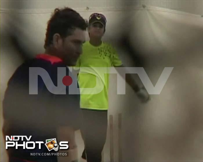 It's not only Team India that is busy sweating it out at the nets in Australia, Arjun Tendulkar was spotted practicing with dad Sachin and India opener Virender Sehwag at an indoor facility in Melbourne.