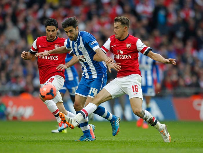 Arsenal centre-back Per Mertesacker cancelled out Wigan midfielder Jordi Gomez' early lead to take the game into extra-time and eventually into penalties.