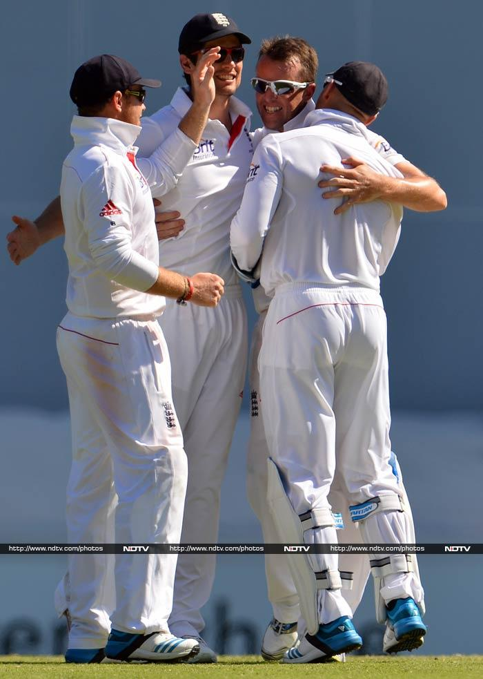 While Warner eventually fell to Stuart Broad, Graeme Swann (in pic) removed Clarke.