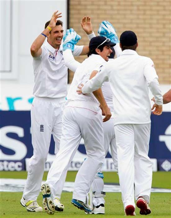 England batsmen may have fallen in a heap on 215 but the bowlers brought the team back. Steven Finn is seen celebrating one of his two wickets. He first dismissed Shane Watson (13) and returned to remove Ed Cowan off the next delivery.