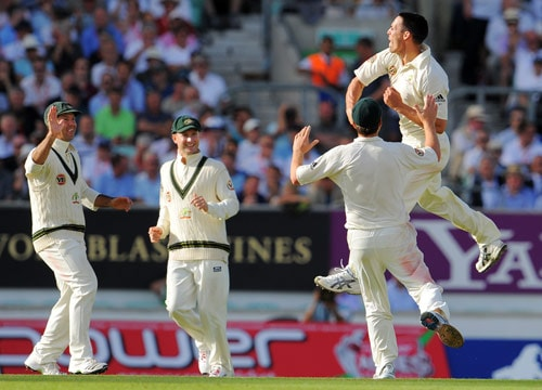 Australian paceman Mitchell Johnson celebrates with his team-mates after dismissing England batsman Matt Prior on the first day of the fifth and final Ashes Test match between England and Australia at the Brit Oval in London on Thursday. (AFP Photo)