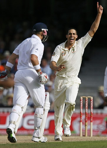 Australian bowler Mitchell Johnson celebrates the wicket of England's Matthew Prior after he was caught for 18 by Shane Watson on the first day of the fifth and final Ashes Test match between England and Australia at the Brit Oval in London on Thursday. (AFP Photo)