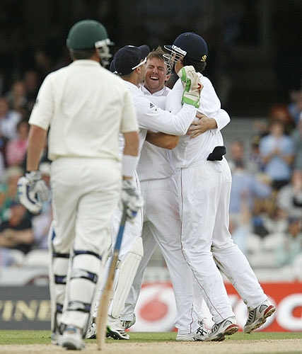 England's Graeme Swann celebrates taking the wicket of Australia's Marcus North on the second day of the fifth and final Ashes Test match at the Brit Oval in London, on Friday. (AFP Photo)