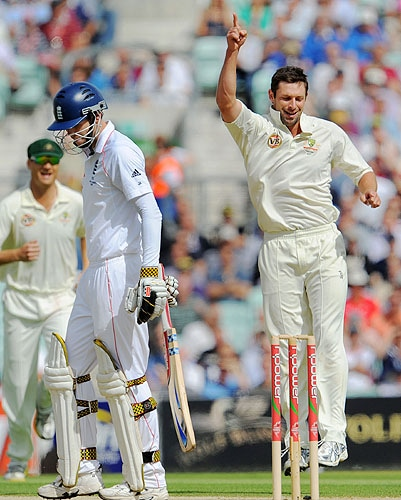 Australian paceman Ben Hilfenhaus celebrates dismissing England batsman James Anderson for a duck on the second day of the fifth and final Ashes Test match at the Brit Oval in London, on Friday. (AFP Photo)