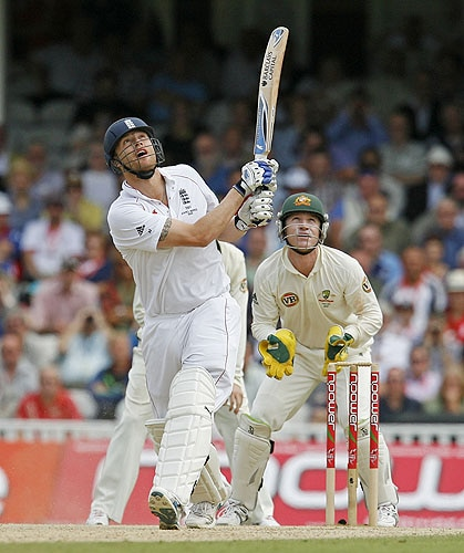 England's Andrew Flintoff is caught out with this shot by Australia's Peter Siddle for 22 runs on his last Test innings watched by Australia's Brad Haddin during the third day of the final Ashes Test at the Brit Oval in London, on Saturday. (AFP Photo)