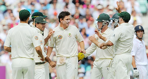 Australian spinner Marcus North is congratulated by team-mates after dismissing England batsman Andrew Strauss during the third day of the final Ashes Test match at the Brit Oval in London, on Saturday. (AFP Photo)
