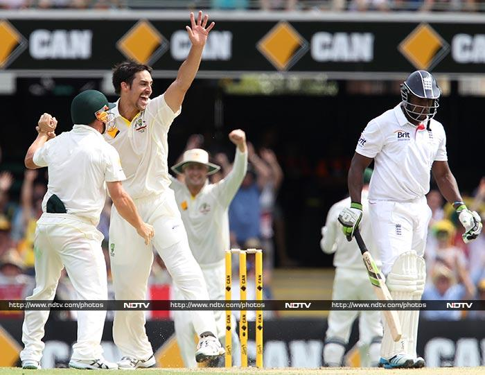 Mitchell Johnson - the hero of the day - then came in and bulldozed his through England's famed batting line-up. <br><br>He is seen celebrating the wicket of the other opener - Michael Carberry (40), who was one of his four wickets.