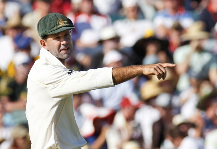 Australia's captain Ricky Ponting directs players on day three of the third Ashes cricket test in Perth. (AP Photo)
