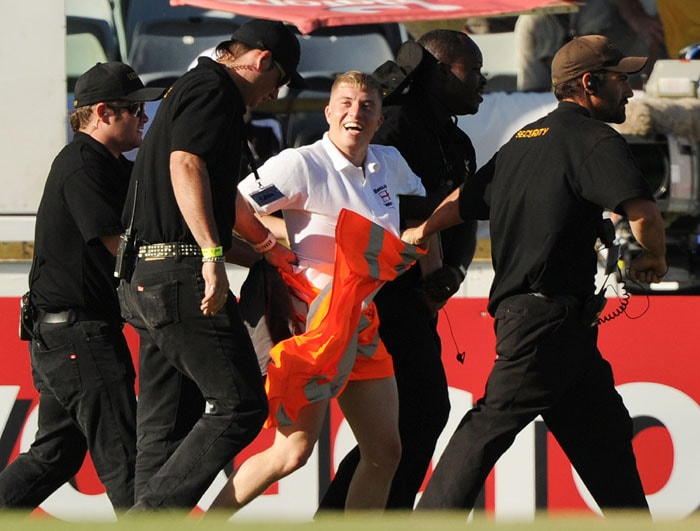A streaker is led away by security on day three of the third Ashes cricket Test at the WACA Ground in Perth. (AFP Photo)