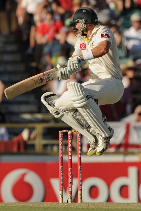 <b>Day 2:</b> Shane Watson jumps as he plays a shot during Australia's second innings on day two of the third Ashes Test against England at the WACA Ground in Perth. (AFP Photo)