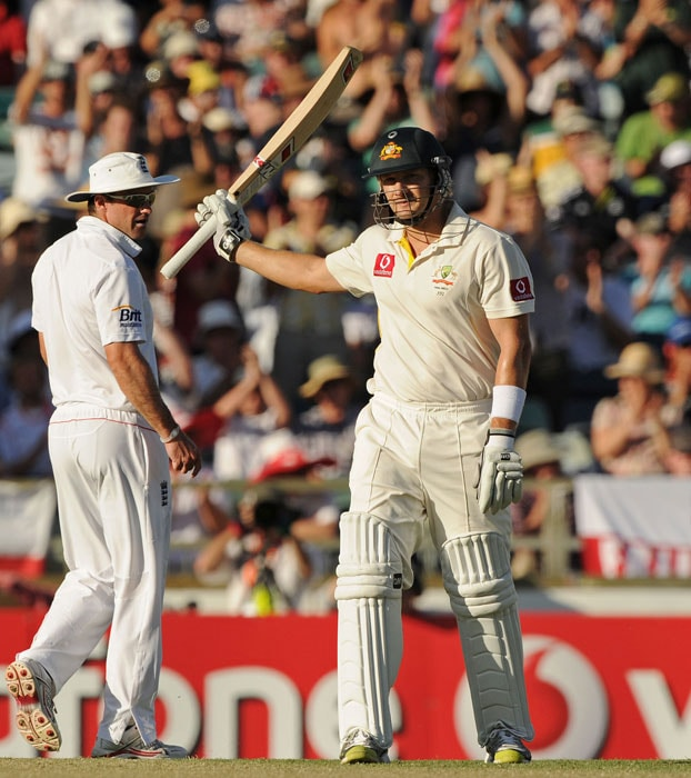 <b>Day 2:</b> Shane Watson waves his bat after reaching his 50 during Australia's second innings on day two of the third Ashes Test against England at the WACA Ground in Perth. (AFP Photo)