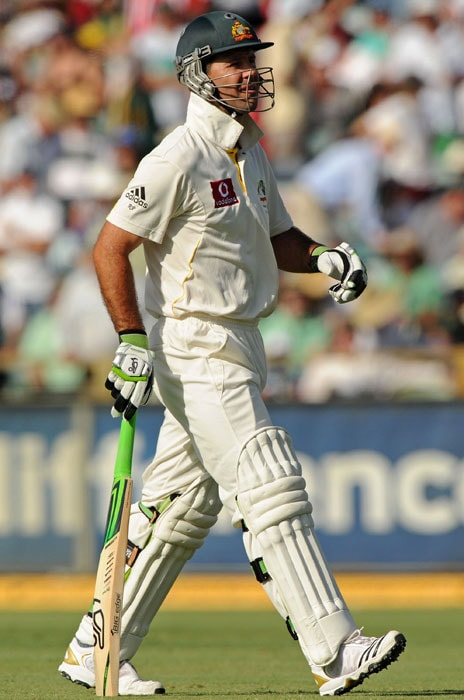 <b>Day 2:</b> Ricky Ponting leaves the ground after being dismissed for one run in Australia's second innings on day two of the third Ashes Test against England at the WACA Ground in Perth. (AFP Photo)