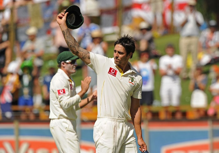<b>Day 2:</b> Mitchell Johnson waves to spectators as he leaves the ground after taking six wickets on day two of the third Ashes Test against England at the WACA Ground in Perth. (AFP Photo)