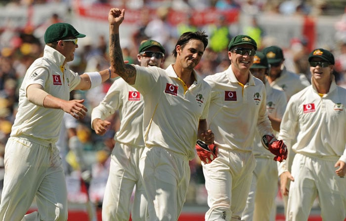 <b>Day 2:</b> Mitchell Johnson celebrates as he captures his fifth wicket, that of Chris Tremlett on day two of the third Ashes Test against England at the WACA Ground in Perth. (AFP Photo)