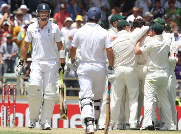<b>Day 2:</b> Kevin Pietersen waits for the decision from the third umpire over an appeal for lbw off the bowling of Mitchell Johnson on the second day of the third Ashes Test match at the WACA ground in Perth. (AFP Photo)