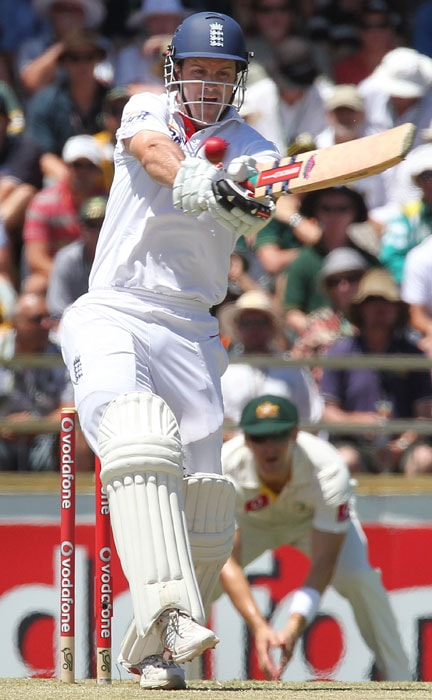 <b>Day 2:</b> England captain and opening batsman Andrew Strauss plays a pull shot to the boundary on the second day the third Ashes Test match at the WACA ground in Perth. (AFP Photo)